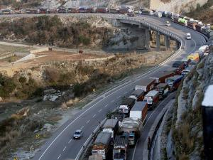 Vehicles waiting in a queue after the Jammu-Srinagar National Highway resumed for vehicular movement, at Nagrota area