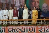 Prime Minister Narendra Modi greets  to crowd as actress and BJP MP Hema Malini