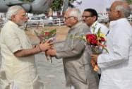 Prime Minister Narendra Modi is welcomed by UP governor Ram Naik