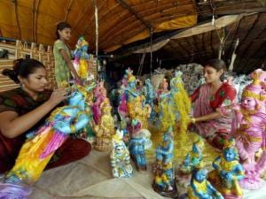 Artists give final touches to idols of Lord Krishna