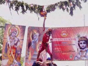 Young girls form a human chain pyramid to break a 'Dahi Handi' as they celebrate Krishna Janmashtami