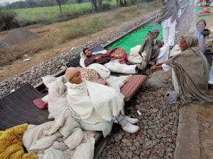 Jat community members at the railway tracks during the second of their agitation for reservation in Hisar