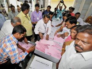 Counting of votes for Assembly elections in progress at a counting centre in Coimbatore