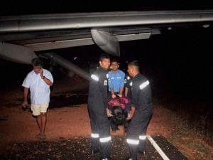 An injured passenger is carried for treatment after a Jet Airways flight veered off the runway at Goa Airport in Dabolim