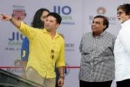 Sachin Tendulkar along with Mukesh Ambani and  Abhishek Bachchan