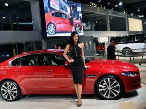 Actress Katrina Kaif poses with a Jaguar Land Rover