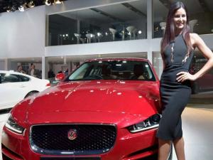 Katrina Kaif poses with a Jaguar XE