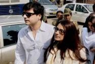 Film actress Sonali Bendre with her husband Goldie Behl arrives to appear in a court in Jodhpur