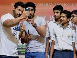 John Abraham and boxer Vijender Singh take selfie along with school children