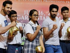 John Abraham and Vijender Singh along with school children during a promotional event