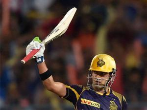 KKR batsman Gautam Gambhir acknowledges the cheers from the crowd after completing his half century during IPL Match against Mumbai Indians in Kolkata.
