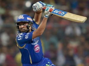 Mumbai Indian batsman Rohit Sharma_plays a shot during IPL Match against KKR  in Kolkata.