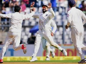 India captain Virat Kohli celebrates with teammates the wicket of Adil Rashid