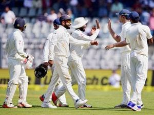 Indian team celebrates the wicket of Jos Butler