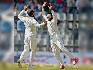 Virat Kohli celebrates with Ravindra Jadeja the wicket of Adil Rashid