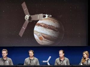 Jim Green, director, Planetary Science Division, NASA, left, talks during a media briefing joined by Scott Bolton, Juno principal investigator
