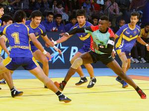 Thailand team trying to catch a player of Kenya team during Kabaddi World Cup 2016