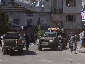 Security forces inspect near the site of an explosion in Kabul