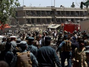 Security forces inspect the site of a suicide attack where the German Embassy is located in Kabul