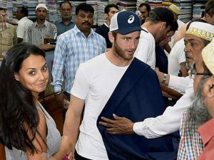 New Zealand captain Kane Williamson selects a suit length at a Garments shop in Kolkata