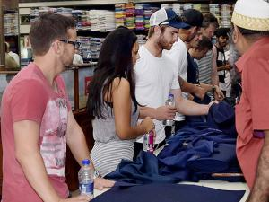 New Zealand cricketers busy in shopping at a garments shop