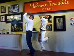 Kapil Dev poses with a wax figure of himself