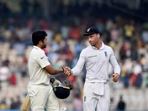 Indian batsman Karun Nair being conguratulated by England's Jos Buttler after scoring 300 runs