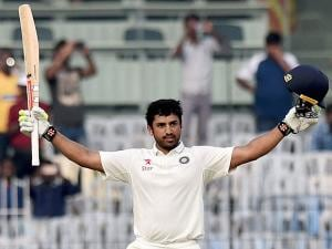 Indian batsman Karun Nair celebrates after scoring 300 runs