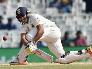 Indian batsman Karun Nair plays a shot during the fourth day of the fifth cricket test match