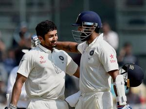 Karun Nair being congratulated by teammate Murali Vijay after he scored maiden century