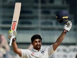 Karun Nair raises his bat after scoring his maiden century