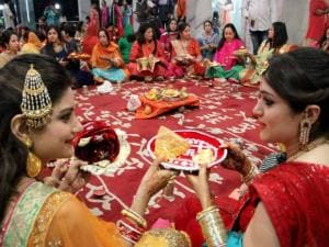 Married women perform rituals during Karva Chauth festival