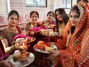 Women perform rituals as they celebrate Karva Chauth
