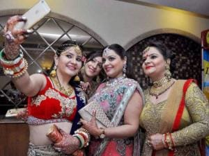 Women take selfie as they celebrate Karva Chauth