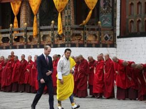 In this photo provided by Royal Kingdom of Bhutan, Britain's Prince William left, walks with Bhutan's king, Jigme Khesar Namgyel Wangchuk, in Thimphu, Bhutan.