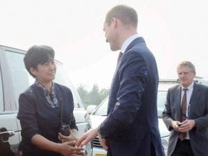 Prince William, Duke of Cambridge bids good-bye to the Security Incharge of the Royal Couple for Assam trip, Gitanjali Doley before departing for Bhutan from Tezpur Airport.