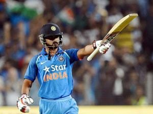 Kedar Jadhav celebrates his century during the first India-England ODI