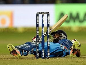 Kedar Jadhav falls during the first India-England ODI at MCA stadium