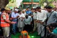 Arvind Kejriwal breaks a coconut at the inauguration of mechanized cleaning