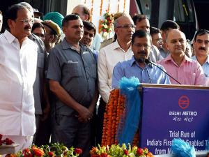 Union Urban Development Minister M Venkaiah Naidu looks on as Delhi Chief Minister Arvind Kejriwal speaks at the launch of the trial run of India's first Unattended Train Operation (UTO) enabled