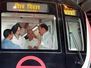 Union Urban Development Minister M Venkaiah Naidu with Delhi Chief Minister Arvind Kejriwal and DMRC MD Mangu Sing inside a train at the flag off ceremony of India's first Unattended Train Operat