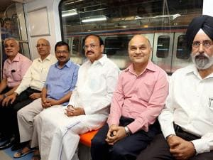 Union Urban Development Minister M Venkaiah Naidu with Delhi Chief Minister Arvind Kejriwal, DMRC MD Mangu Singh and other dignitaries sitting inside a train at the flag off ceremony