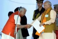 Haryana Governor Kaptan Singh Solanki greets the newly sworn-in Chief Minister Manohar Lal Khattar