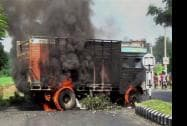 Locals set ablaze a truck at the National Highway 39 at Pura Bangla in Golaghat district