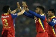 Yuzvendra Chahal of the Royal Challengers Bangalore congratulates Mandeep Singh