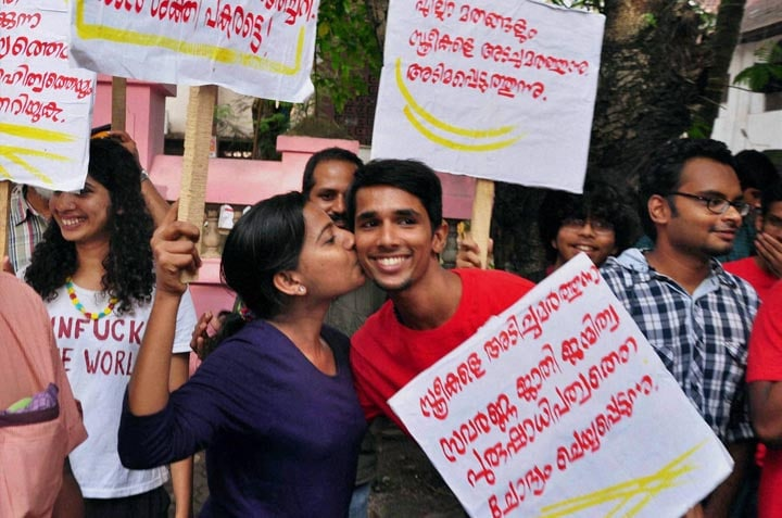 girl, kisses, boy, support, Kiss of Love,  protest rally, Kochi