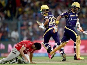 KKR batsman Gautam Gambhir and Robin Uthappa cross each other to complete a run during their IPL match at Eden Garden in Kolkata