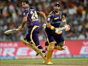 KKR batsmen Robin Uthappa and Yusuf Pathan cross each other to complete singles during IPL match against Kings XI Punjab at Eden Garden in Kolkata