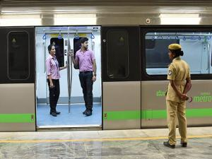 Metro employees stand inside the metro train at Majestic metro station
