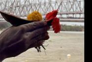 "A devotee offers ""Tarpan"" during Mahalaya at the bank of River Ganga"